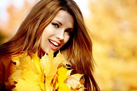 confident-woman-smiling-fall-background